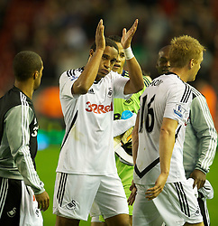 05.11.2011, Anfield Stadion, Liverpool, ENG, Premier League, FC Liverpool vs Swansea City, im Bild Swansea City's Ashley Williams applauds the supporters after his side's goal-less draw against Liverpool  // during the premier league match between FC Liverpool vs Swansea City at Anfield Stadium, Liverpool, EnG on 05/11/2011. EXPA Pictures © 2011, PhotoCredit: EXPA/ Propaganda Photo/ David Rawcliff +++++ ATTENTION - OUT OF ENGLAND/GBR+++++