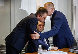 May 4, 2017 - Kiev, Ukraine - Viktor Yanukovych (not present) defenders put heads together during the court hearing. Obolon district court of Kyiv starts the preliminary hearing of ex-President Viktor Yanukovych high treason case, Kyiv, Ukraine, May 4, 2017. (Credit Image: © Sergii Kharchenko/NurPhoto via ZUMA Press)