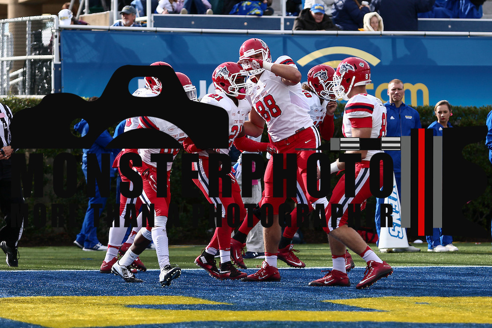 Stony Brook running back STACEY BEDELL (21) celebrates with his teammates in the end zone after rushing for a 20 yard touchdown during a week eight game between the Delaware Blue Hens and the Stony Brook Seawolves, Saturday, Oct. 22, 2016 at Tubby Raymond Field at Delaware Stadium in Newark, DE.