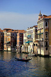 Venice, Italy:  A single, lonely gondola on the Grand Canal -- end of day.