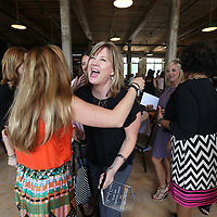 Bev Crossen gets congratulated by friends and co-workers after winning the 2017 Influential Woman of the Year award on Tuesday.