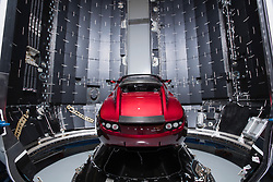 December 22, 2017 - Hawthorne, California, U.S. - Earlier this month Tesla CEO Elon Musk announced that SpaceX's Falcon Heavy will have a payload on its maiden launch that will be none other than his very own Cherry Red Tesla Roadster. Friday, Musk revealed the setup in a photo slideshow posted to Social media. The Roadster appears bright red in the center of SpaceX's slate grey rocket, called Falcon Heavy and will undergoe a billion year elliptic Mars orbit. Image Taken Dec. 5th, 2017. (Credit Image: © Space X/ZUMA Wire/ZUMAPRESS.com)
