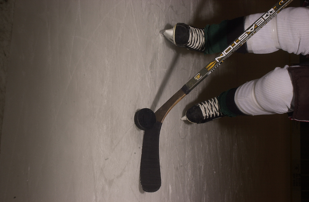 15696Hockey Puck & Stick on Ice with Skates for Poster
