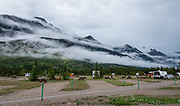 Fog enshrouds peaks over Snaring River Overflow Campground, Jasper National Park, Canadian Rockies, Alberta, Canada. Jasper is the largest national park in the Canadian Rocky Mountain Parks World Heritage Site, honored by UNESCO in 1984.