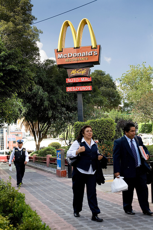 People walk by a McDonalds in Mexico City.