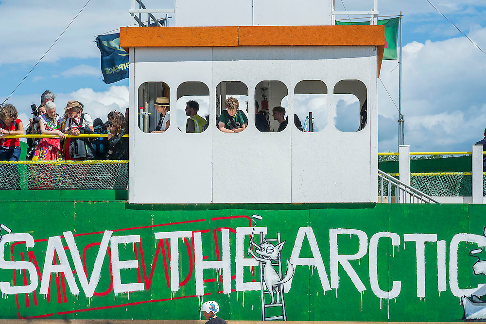 Vivienne Westwood (pictured second left on the bridge) visits the Greenpeace area which includes a huge mock uo of the Arctic Sunrise , an exhibition of images aof the imprisoned Arctic 30 and a giant animatronic polar bear - all aimed at 'Saving the Arctic'. The 2014 Glastonbury Festival, Worthy Farm, Glastonbury. 27 June 2013.  Guy Bell, 07771 786236, guy@gbphotos.com
