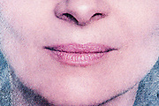 mouth close up with a natural pink type of lipstick with halftone print dots