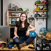 """February 24, 2014 - New York, NY : <br /> Danielle Baskin, founder of Belle Helmets, poses for a portrait in her office/studio space at 115 E. 23rd Street in Manhattan on Monday afternoon, Feb. 24. Danielle hand-paints bicycle helmets, which she sells to clients in New York and across the globe. Her setup includes a 21.5"""" iMac, visible at left, and an iPhone 5S, in foreground at center right in an OtterBox case.  <br /> CREDIT: Karsten Moran for Macworld Magazin"""