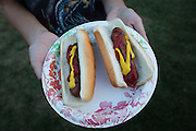 Guests received complimentary hot dogs, nachos, and sodas prepared by the Association of Retired San Jose Police Officers and Firefighters during the National Night Out event at Berryessa Creek Park in San Jose, California, on August 5, 2014. (Stan Olszewski/SOSKIphoto)