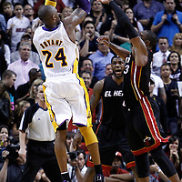 10 March 2011: Los Angeles Lakers shooting guard Kobe Bryant (24) takes a jumpshot over Miami Heat shooting guard Dwyane Wade (3) during the Miami Heat 94-88 victory over the Los Angeles Lakers at the AmericanAirlines Arena, Miami, Florida, USA.