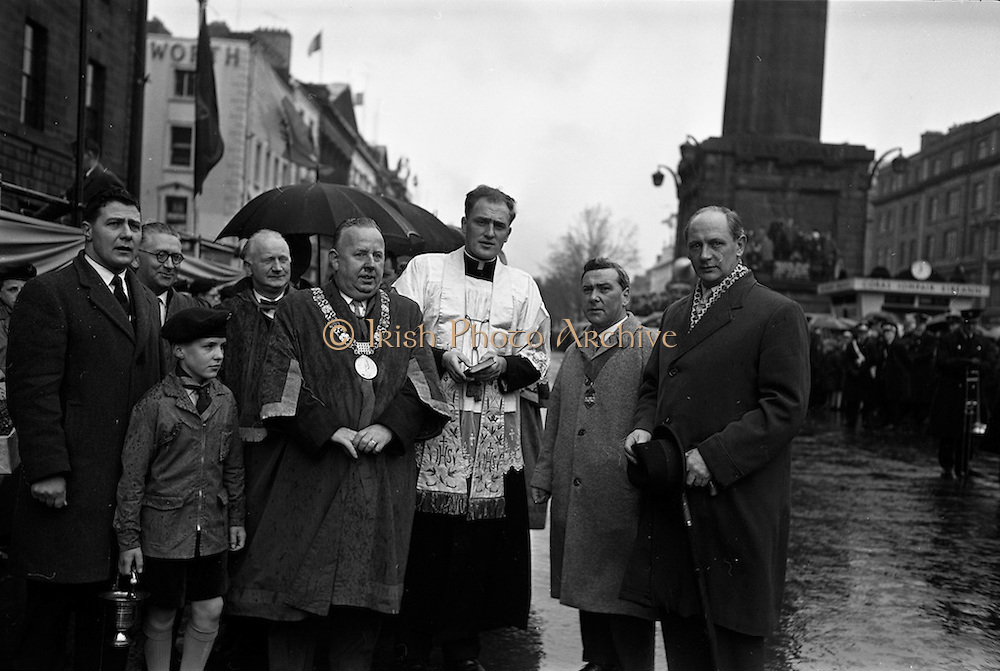 17/03/1963<br /> 03/17/1963<br /> 17 March 1963<br /> At the reviewing stand at the N.A.I.D.A. annual St. Patrick's Day Industrial Parade on O'Connell Street Dublin, were (r-l): Jack Lynch, Minister for Industry and Commerce; Aodhagan Brioscu, President of the N.A.I.D.A.; Priest (unknown); and the Lord Mayor of Dublin, Alderman J.J. O'Keeffe, T.D..