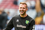 A smiling Norwich City striker (on loan from Sheffield Wednesday) Jordan Rhodes (11)  warms up during the EFL Sky Bet Championship match between Aston Villa and Norwich City at Villa Park, Birmingham, England on 5 May 2019.