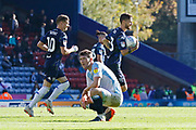 Goalscorer Leeds United midfielder Mateusz Klich (43) runs  with the ball past a dejected Blackburn Rovers Richard Smallwood  during the EFL Sky Bet Championship match between Blackburn Rovers and Leeds United at Ewood Park, Blackburn, England on 20 October 2018.