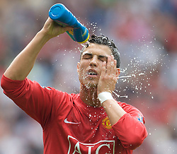 WIGAN, ENGLAND - Sunday, May 11, 2008: Manchester United's Cristiano Ronaldo takes on water during the final Premiership match of the season against Wigan Athletic at the JJB Stadium. (Photo by David Rawcliffe/Propaganda)