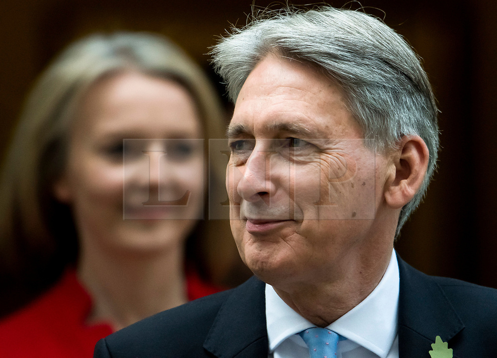 © Licensed to London News Pictures. 29/10/2018. London, UK. Chief Secretary to the Treasury LIZ TRUSS and Chancellor PHILIP HAMMOND leave Number 11 Downing Street in London, before presenting his Budget to Parliament. This will be the last budget before the UK is due to exit the European Union in March of 2019. Photo credit: Ben Cawthra/LNP