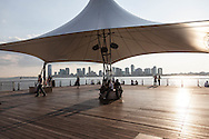 New York , Hudson riverside, Christopher Street Pier (officially Pier 45) is part of the Hudson River Park - a 5-mile strip of parks, gardens and piers interconnected by a pathway for biking/jogging/walking along the west side of Manhattan, a largest park development project