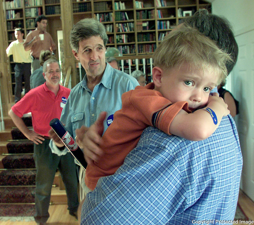 KERRY-- ackworth, june 29 -- Sen. John Kerry, D-Mass., tries to get the attention of 3-year old Jacob Appel, who is being held by his father Brent Appel.  Kerry was at the Appel home in Ackworth on behalf of John Norris, who is running for the 4th Congressional District House seat.  photo by david peterson