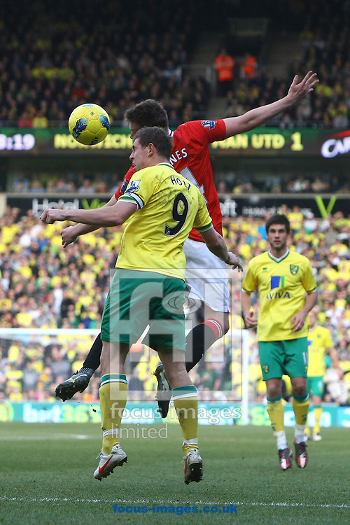Picture by Paul Chesterton/Focus Images Ltd.  07904 640267.26/02/12.Grant Holt of Norwich and Phil Jones of Man Utd in action during the Barclays Premier League match at Carrow Road Stadium, Norwich.