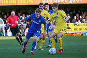 AFC Wimbledon Jack Rudoni (12) taking on Fleetwood Town defender Lewis Gibson (19) during the EFL Sky Bet League 1 match between AFC Wimbledon and Fleetwood Town at the Cherry Red Records Stadium, Kingston, England on 8 February 2020.