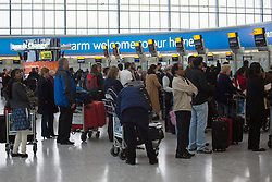 © licensed to London News Pictures. London, UK 31/10/2012. Passengers from Heathrow to the east coast destinations in the US queuing to check in as the US flights returning to normal at Heathrow Terminal 5 after Hurricane Sandy hit the east coast in the US. Photo credit: Tolga Akmen/LNP