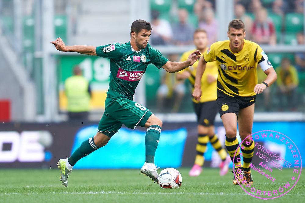 (L) Mateusz Machaj of Slask Wroclaw controls the ball during international friendly soccer match between WKS Slask Wroclaw and BVB Borussia Dortmund on Municipal Stadium in Wroclaw, Poland.<br /> <br /> Poland, Wroclaw, August 6, 2014<br /> <br /> Picture also available in RAW (NEF) or TIFF format on special request.<br /> <br /> For editorial use only. Any commercial or promotional use requires permission.<br /> <br /> Mandatory credit:<br /> Photo by &copy; Adam Nurkiewicz / Mediasport