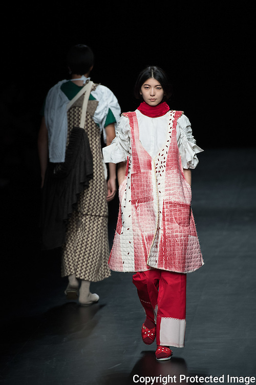 "OCTOBER 23: A model  presents the BAGASAO collection at the Amazon Fashion Week Tokyo's 2017 Spring/Summer during the Asian Fashion meets Tokyo show under way at Shibuya Hikarie in Tokyo on Oct. 23, 2016. and other locations through 23rd. Joseph Agustin S. Bagasao graduated from BS Psychology before finishing Fashion Design & Technology at the Fashion Institute of the Philippines. Having been awarded ""Designer of the Year"" in 2011 by the school, he was sent to Paris on a fashion trip as a recognition for his talent. In the same year, he was selected as one of the Philippines ""Emerging Fashion Talent"" awardees by Preview Magazine and in 2012 as ""Designers to Watch for"" by Meg Magazine. In 2013, he was chosen as one of the top 10 finalists in the Style Awards of the Philippines. He continued to hone his craft by interning for Filipino designers and eventually became a designer for the high-end international retail brand Josie Natori until he founded his brand Bagasao in 2015. Nearly 50 fashion brands and companies will hold their shows at several locations through 23rd..23/10/2016-Tokyo, JAPAN"