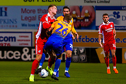 Jason Law of Mansfield Town and Stephen Humphrys of Scunthorpe United collide - Mandatory by-line: Ryan Crockett/JMP - 13/11/2018 - FOOTBALL - One Call Stadium - Mansfield, England - Mansfield Town v Scunthorpe United - Checkatrade Trophy