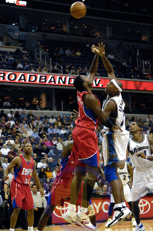 20 November 2007:   Washington Wizards center Brendan Haywood (33) scores over Philadelphia 76ers center Samuel Dalembert (1) in the first half at the Verizon Center in Washington, D.C.  The Wizards defeated the 76'ers for their 5th consecutive victory 116-101.