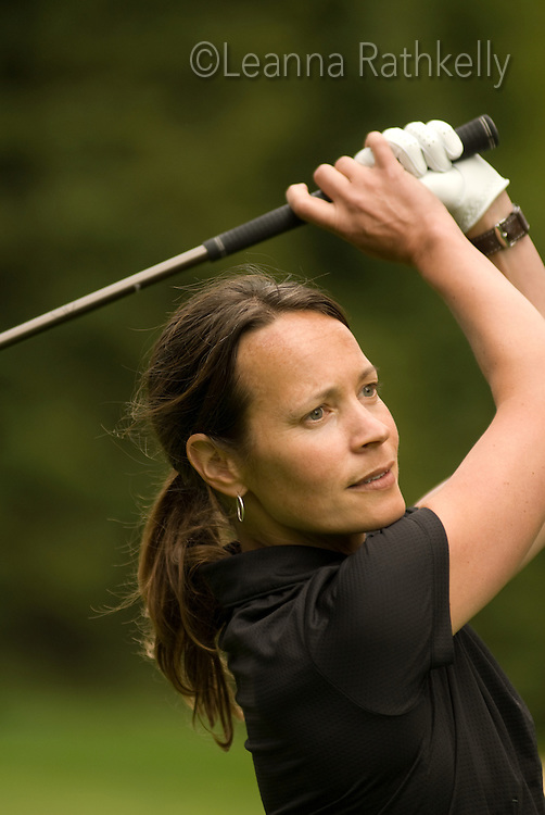 Sophia Lundgren closeup as she hits the golf ball off the first tee on the Whistler Golf Course, Whistler, BC Canada