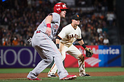 San Francisco Giants third baseman Christian Arroyo (22) covers third base against the Cincinnati Reds at AT&T Park in San Francisco, California, on May 11, 2017. (Stan Olszewski/Special to S.F. Examiner)