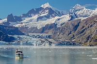 Sightseeing vessel in front of Johns Hopkins Glacier in Glacier Bay National Park and Preserve, Alaska.