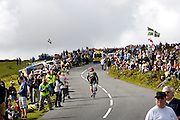 UK, September 15 2011: Spectators flank the climb to Haytor during the fifth stage of the 2011 Tour of Britain. The stage started in Exeter and finished in Exmouth. Copyright 2011 Peter Horrell
