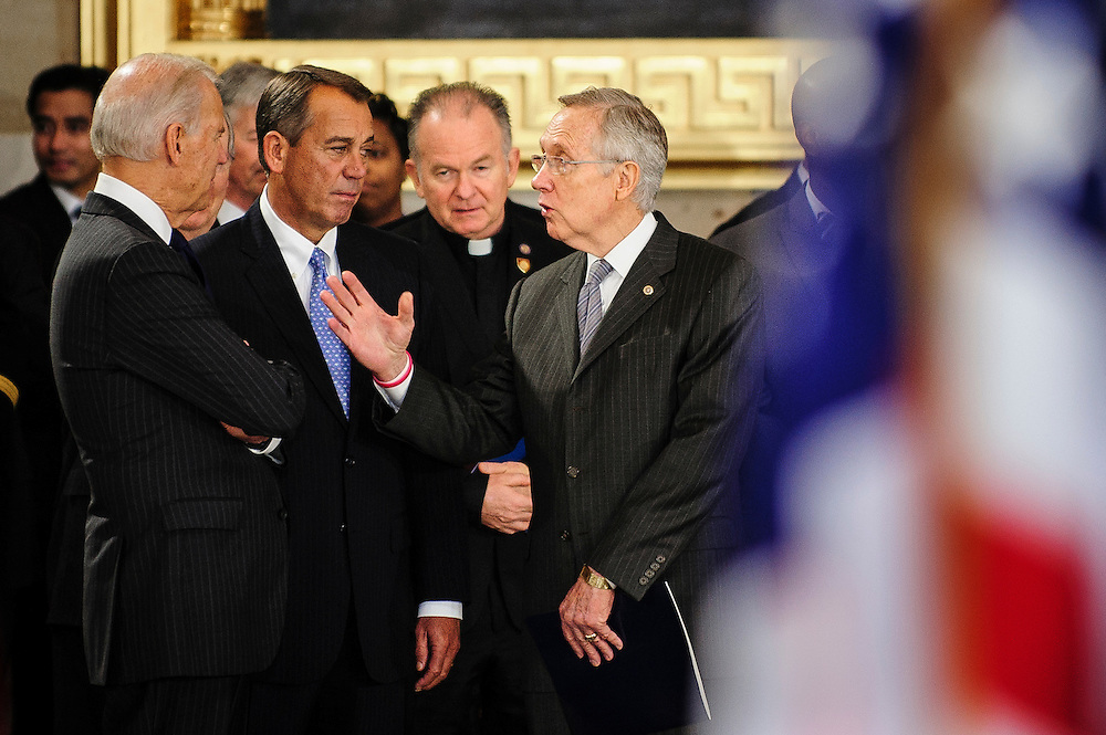 Vice President JOE BIDEN, Speaker of the House JOHN BOEHNER (R-OH) and Senate Majority Leader HARRY REID (D-NV) converse at the U.S. Capitol on Thursday before a service and public viewing of the late Senator Daniel Inouye (D-HI) who passed away at the age of 88 on December 18 at the Walter Reed National Military Medical Center in Bethesda, Md. Inouye, 88, a decorated World War II veteran and the second-longest serving senator in history will lie in state in the Capitol Rotunda until Friday when a memorial service will be held at the National Cathedral.