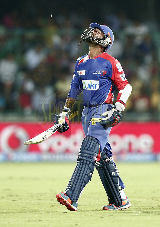 Dinesh Karthik of the Delhi Daredevils walk back to pavilion after caught by Mohit Sharma of The Chennai Superkings during match 26 of the Pepsi Indian Premier League Season 2014 between the Delhi Daredevils and the Chennai Superkings held at the Ferozeshah Kotla cricket stadium, Delhi, India on the 5th May  2014<br /> <br /> Photo by Deepak Malik / IPL / SPORTZPICS<br /> <br /> <br /> <br /> Image use subject to terms and conditions which can be found here:  http://sportzpics.photoshelter.com/gallery/Pepsi-IPL-Image-terms-and-conditions/G00004VW1IVJ.gB0/C0000TScjhBM6ikg