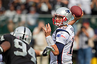 02 October 2011: Quarterback (12) Tom Brady of the New England Patriots passes the ball against the Oakland Raiders during the second half of the Patriots 31-19 victory against the Raiders in an NFL football game at O.co Stadium in Oakland, CA.