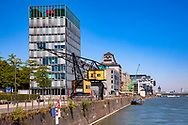 the river Rhine promenade in the Rheinau harbor, office building KAP am Suedkai by Engel und Zimmermann architects, Cologne, Germany.<br /> <br /> die Rheinpromenade im Rheinauhafen, Buerogebaeude KAP am Suedkai der Architekten Engel und Zimmermann, Koeln, Deutschland.