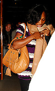 06.JULY.2007. LONDON<br /> <br /> LADIES WIMBELDON FINALIST SERENA WILLIAMS EATS OUT WITH FRIENDS AT THE ZUMA BAR RESTAURANT, WHEN LEAVING SHE COVERD UP HER FACE AND SHE ALSO HAD A WRIST SUPPORT ON.<br /> <br /> BYLINE: EDBIMAGEARCHIVE.CO.UK<br /> <br /> *THIS IMAGE IS STRICTLY FOR UK NEWSPAPERS AND MAGAZINES ONLY*<br /> *FOR WORLD WIDE SALES AND WEB USE PLEASE CONTACT EDBIMAGEARCHIVE - 0208 954 5968*