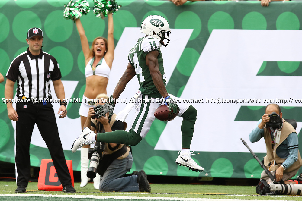 EAST RUTHERFORD, NJ - OCTOBER 15: New York Jets Wide Receiver Jeremy Kerley #14 leaps into the end zone after a reception from New York Jets Quarterback Josh McCown #15 during the first half of a regular season NFL game between the New England Patriots and the New York Jets on October 15, 2017, at MetLife Stadium in East Rutherford, NJ. (Photo by David Hahn/Icon Sportswire)