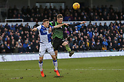 Bristol Rovers Tom Lockyer (4) battles for the ball against  Doncaster Rovers Cody Prior (32) during the EFL Sky Bet League 1 match between Bristol Rovers and Doncaster Rovers at the Memorial Stadium, Bristol, England on 23 December 2017. Photo by Gary Learmonth.