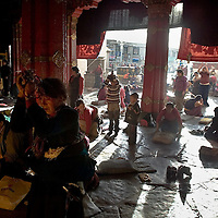 Pilgrims pray during the celebration of Tibetan New Year, in Lasa. Tibet, China/Feb. 21, 2007.