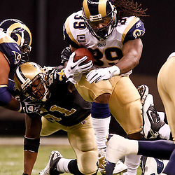 December 12, 2010; New Orleans, LA, USA; St. Louis Rams running back Steven Jackson (39) runs past New Orleans Saints linebacker Jonathan Vilma (51) during the second half at the Louisiana Superdome. Mandatory Credit: Derick E. Hingle-US PRESSWIRE