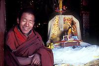Monk at Gandon Monastery, Tibet, near fobidden pictures of the Dalai Lama.1985.Photo by Owen Franken