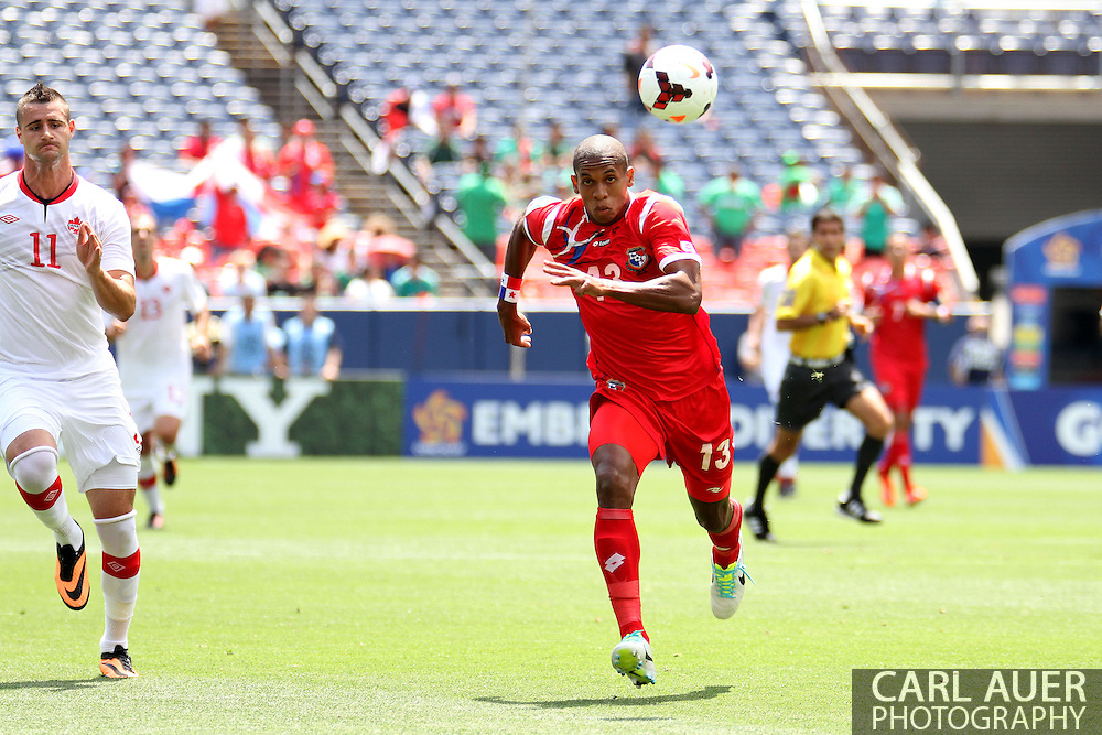 July 14 2013:  Canada Forward Marcus Haber (11) and Panama Defender Jean Carlos Cedeño (13) chase after the ball during the first half of  the CONCACAF Gold Cup soccer match between Panama and Canada at Sports Authority Field in Denver, CO. USA.