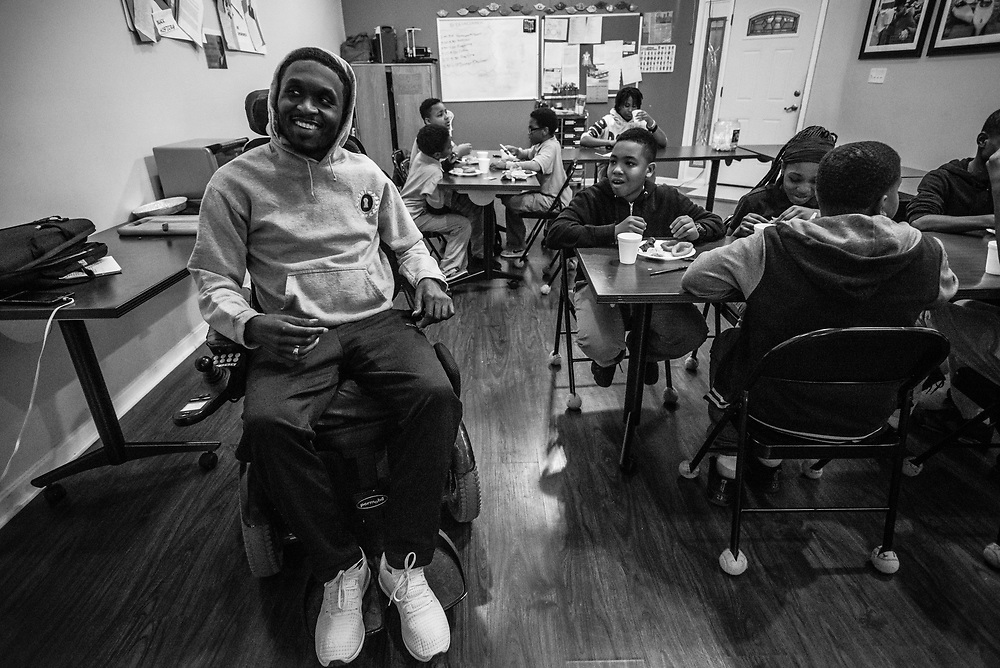 BALTIMORE, MD -- 3/6/17 -- Van Brooks runs the Safe Alternative Center, which he started to give middle school kids in West Baltimore a safe place to learn and play. <br /> <br /> Brooks was a Division 1 prospect when he played football in high school, but was paralyzed in a freak accident after making a tackle in his junior year. He regained the use of his arms, even walking again with much assistance, and graduated on time from high school. He later earned a degree in marketing from Towson University. Though still confined to a wheelchair, he is self-sufficient and runs the center.&hellip;by Andr&eacute; Chung #_AC19450