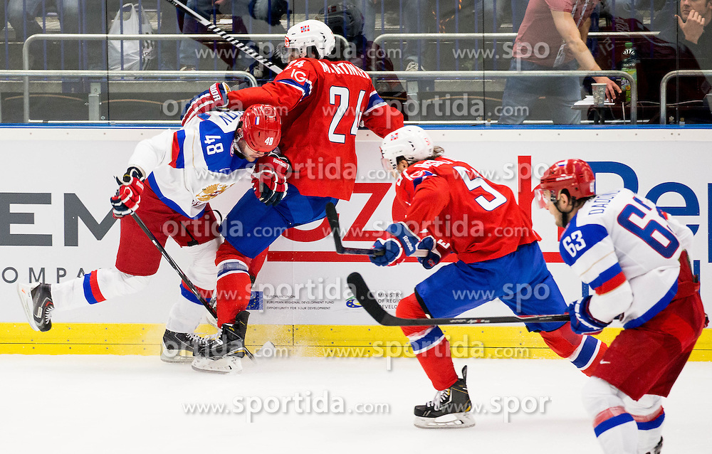 Yevgeni Biryukov of Russia vs Andreas Martinsen of Norway during Ice Hockey match between Russia and Norway at Day 1 in Group B of 2015 IIHF World Championship, on May 1, 2015 in CEZ Arena, Ostrava, Czech Republic. Photo by Vid Ponikvar / Sportida