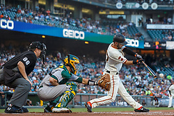 SAN FRANCISCO, CA - AUGUST 13: Joey Rickard #37 of the San Francisco Giants hits a single against the Oakland Athletics during the first inning at Oracle Park on August 13, 2019 in San Francisco, California.  (Photo by Jason O. Watson/Getty Images) *** Local Caption *** Joey Rickard