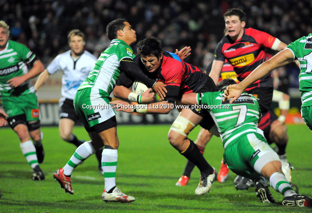 Isaac Ross is tackled by Manawatu's Aaron Smith and Doug Tietjens. ITM Cup rugby - Manawatu Turbos v Canterbury at FMG Stadium, Palmerston North, New Zealand on Friday, 5 August 2010. Photo: Dave Lintott/Photosport