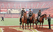 Three police sit on horses on the field after the San Francisco 49ers 1990 NFL NFC Divisional playoff football game against the Minnesota Vikings on Jan. 6, 1990 in San Francisco. The 49ers won the game 41-13. (©Paul Anthony Spinelli)