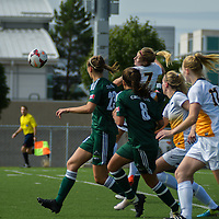 3rd year forward Brianna Wright (7) of the Regina Cougars  heads the ball to goal during the Women's Soccer Homeopener on September 10 at U of R Field. Credit: Arthur Ward/Arthur Images