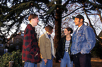 A group of university students  hanging around chatting on campus.